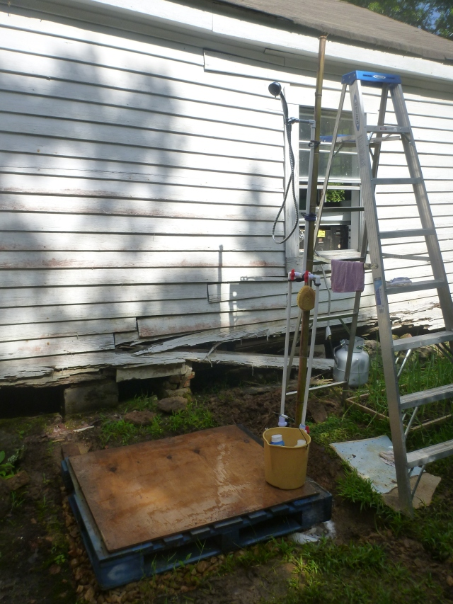 Outdoor shower - with temporary towel rack and clothes holder.
